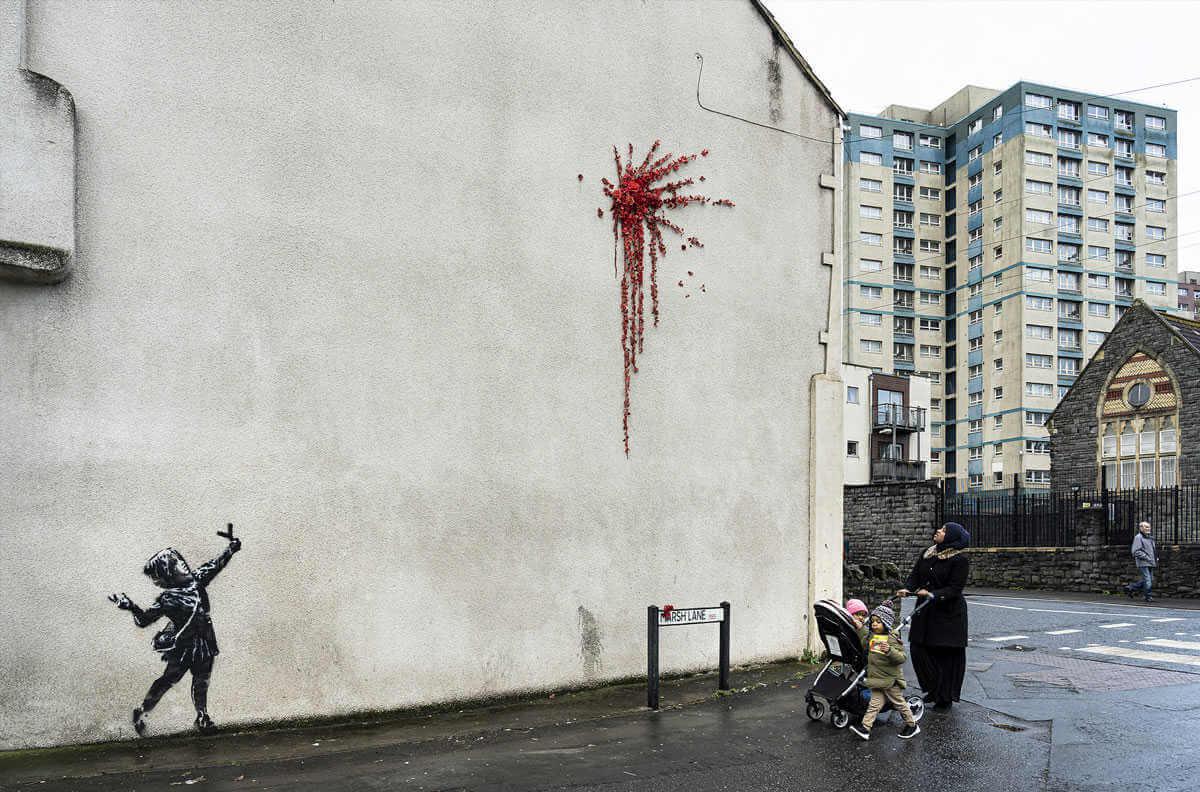 Obra de banksy por san valentin, niña disparando con tirachinas