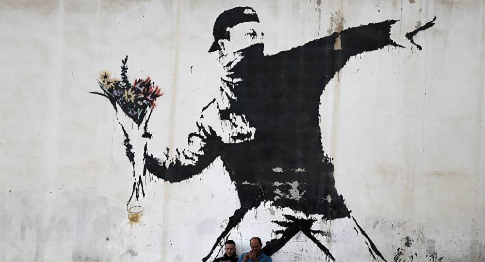 Arrojando flores, Banksy wall art