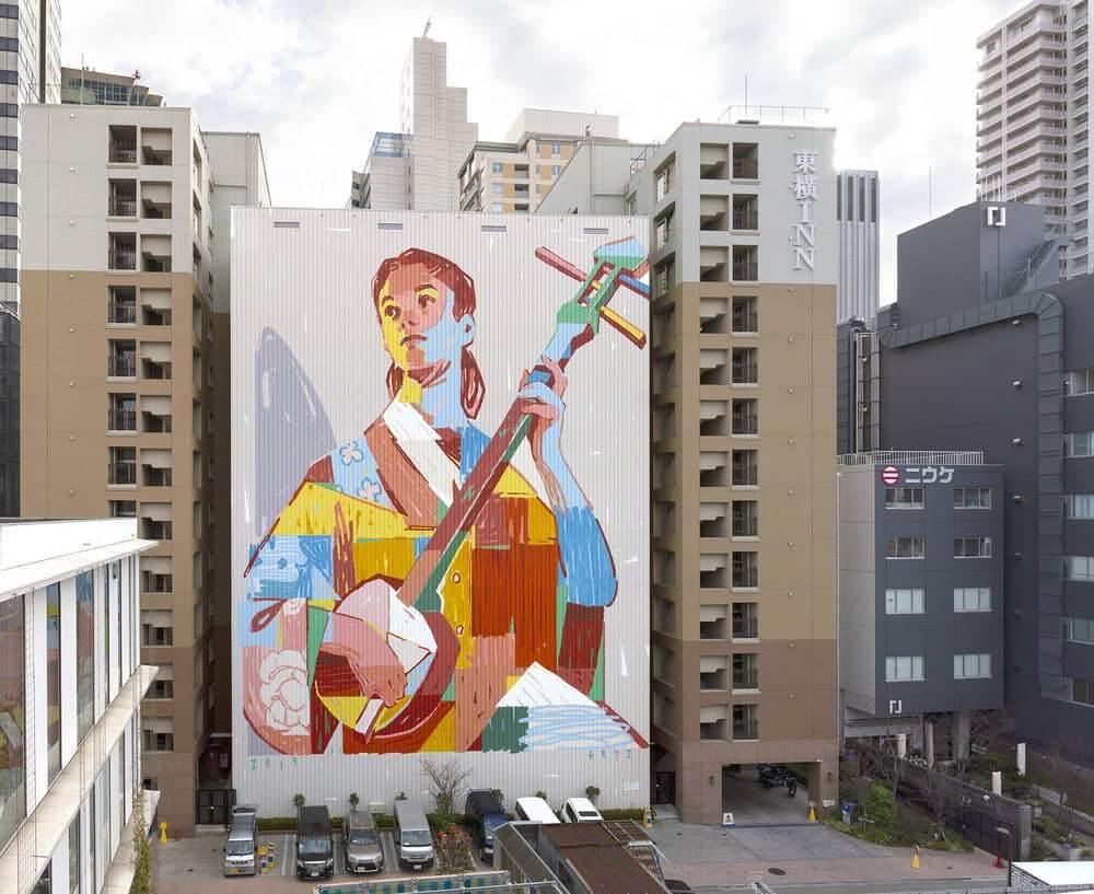 Mural de arte urbano en japon de aryz