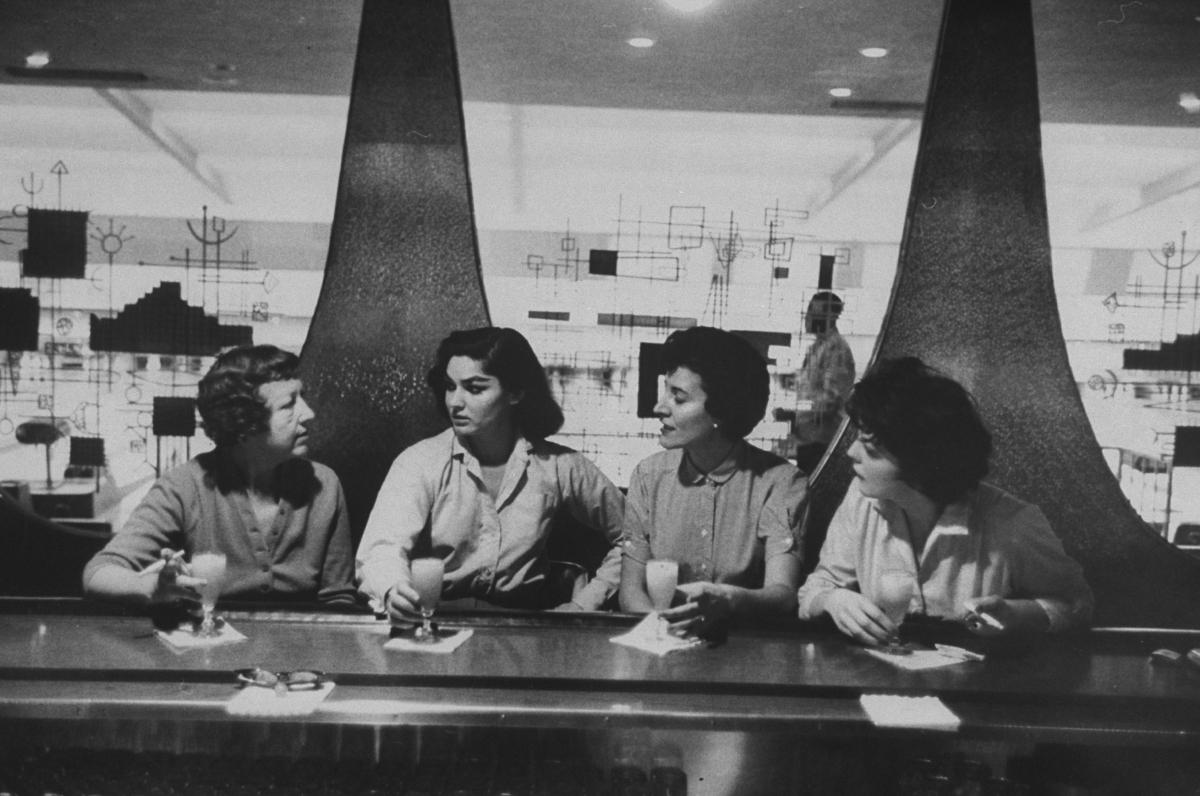 Women at bar in bowling alley celebratin