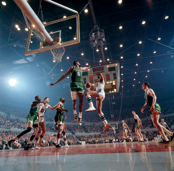 Bill Russell goes for a block