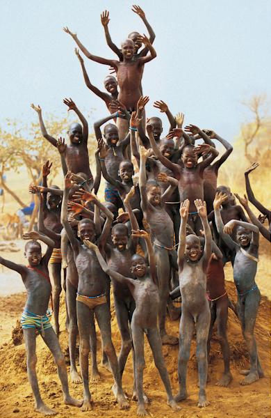 Dinka Children on Termite Mound