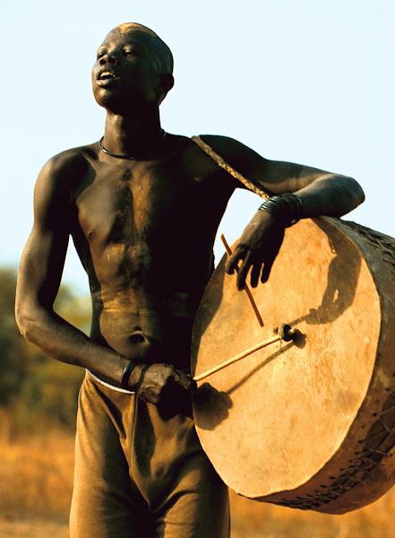 Dinka Man Playing Drum