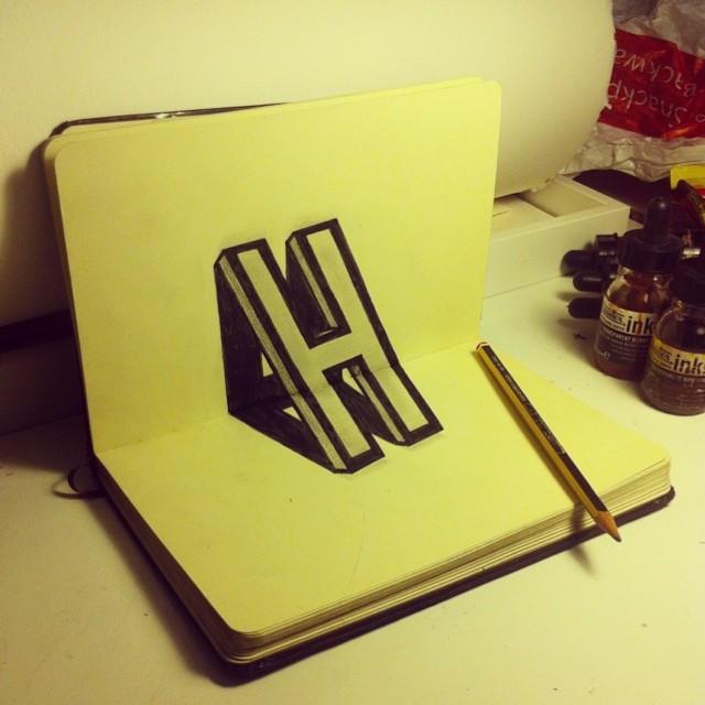 Ilusion optica en un cuaderno de la letra H