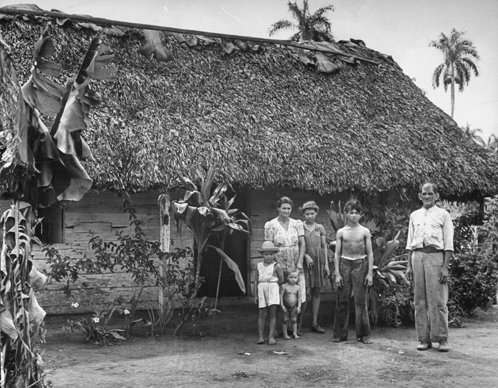 A cane cutter and his family standing in
