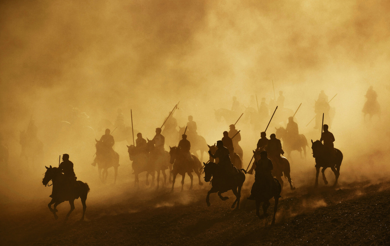 Horsemen holding spears ride during the first running of the bulls in the village of Cuellar, Spain, Sunday, Aug. 30, 2009. Cuellar's running on the bulls are considered as the oldest in Spain dating back to the late fifteenth century. (AP Photo /Daniel Ochoa de Olza)