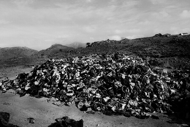 Abandoned: A more than 12ft high pile of life-jackets and dinghies, left behind by migrants and refugees that have successfully made the hazardous journey across the Mediterranean to the Greek island of Lesbos