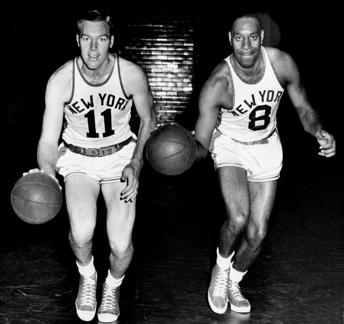 NEW YORK - 1950: Harry Gallatin #11 and Nathaniel Clifton #8 of the New York Knicks pose for a mock action portrait circa 1950 in New York, New York. NOTE TO USER: User expressly acknowledges and agrees that, by downloading and/or using this Photograph, user is consenting to the terms and conditions of the Getty Images License Agreement. Mandatory Copyright Notice: Copyright 1950 NBAE (Photo by NBA Photo Library/NBAE via Getty Images)