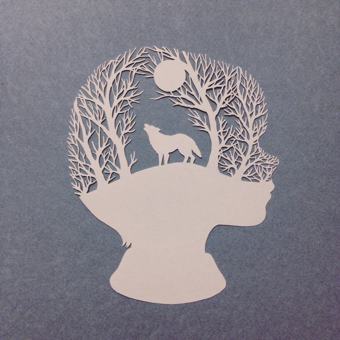 silueta de niño con ciervo hecho con papel cortado por Kanako Abe