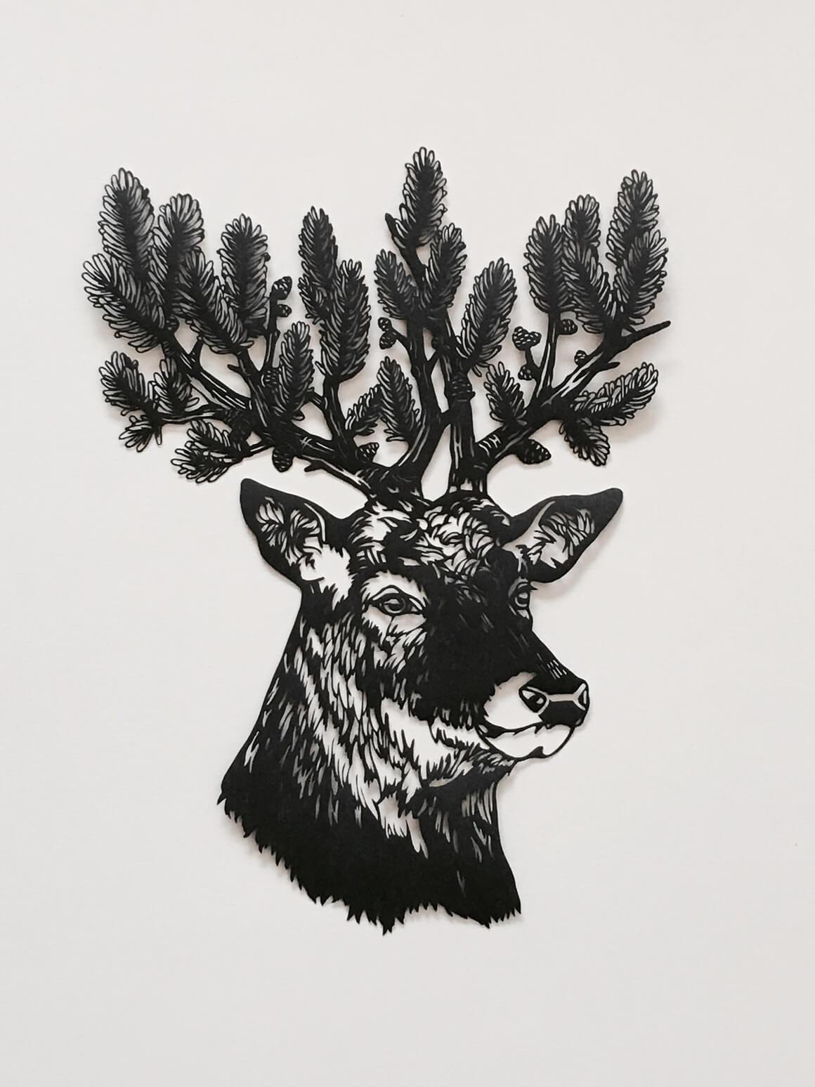 silueta de ciervo hecha con papel cortado a modo de ilustración por Kanako Abe