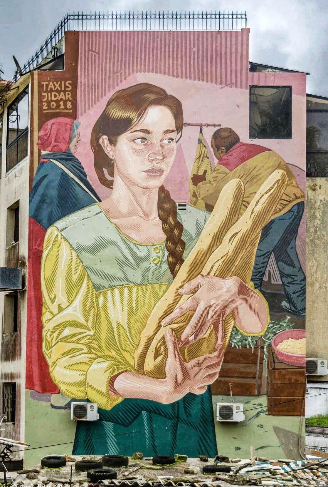 Mujer con pan, graffiti estilo cómic de Dimitris Taxis