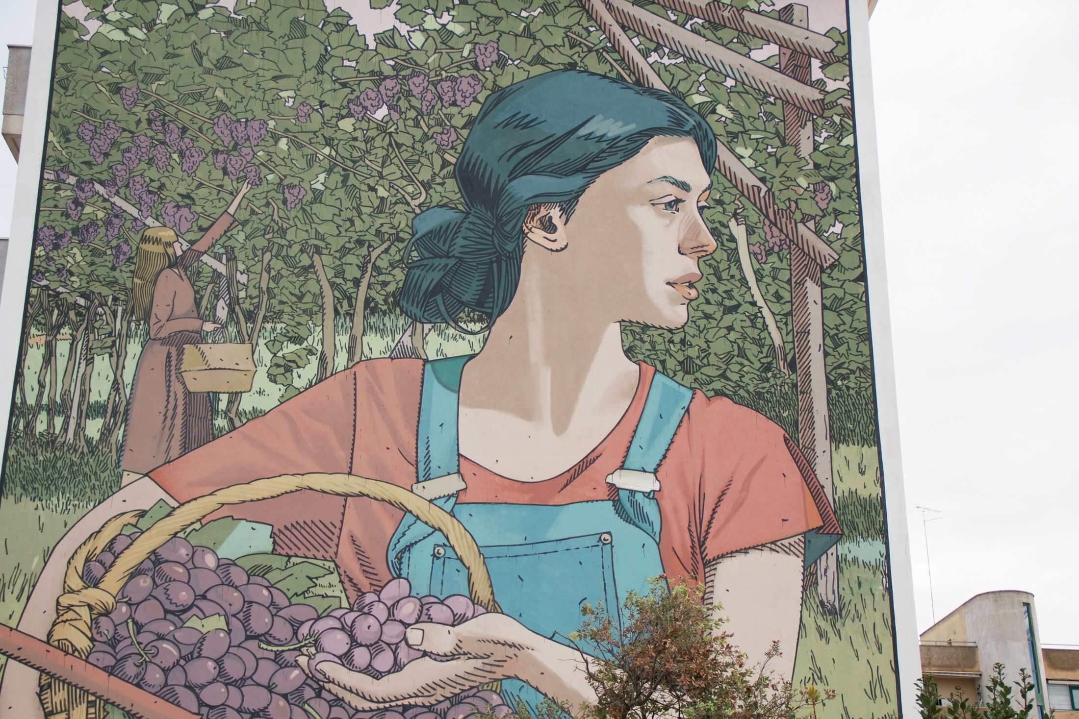 Mujer con uvas graffiti Taxis