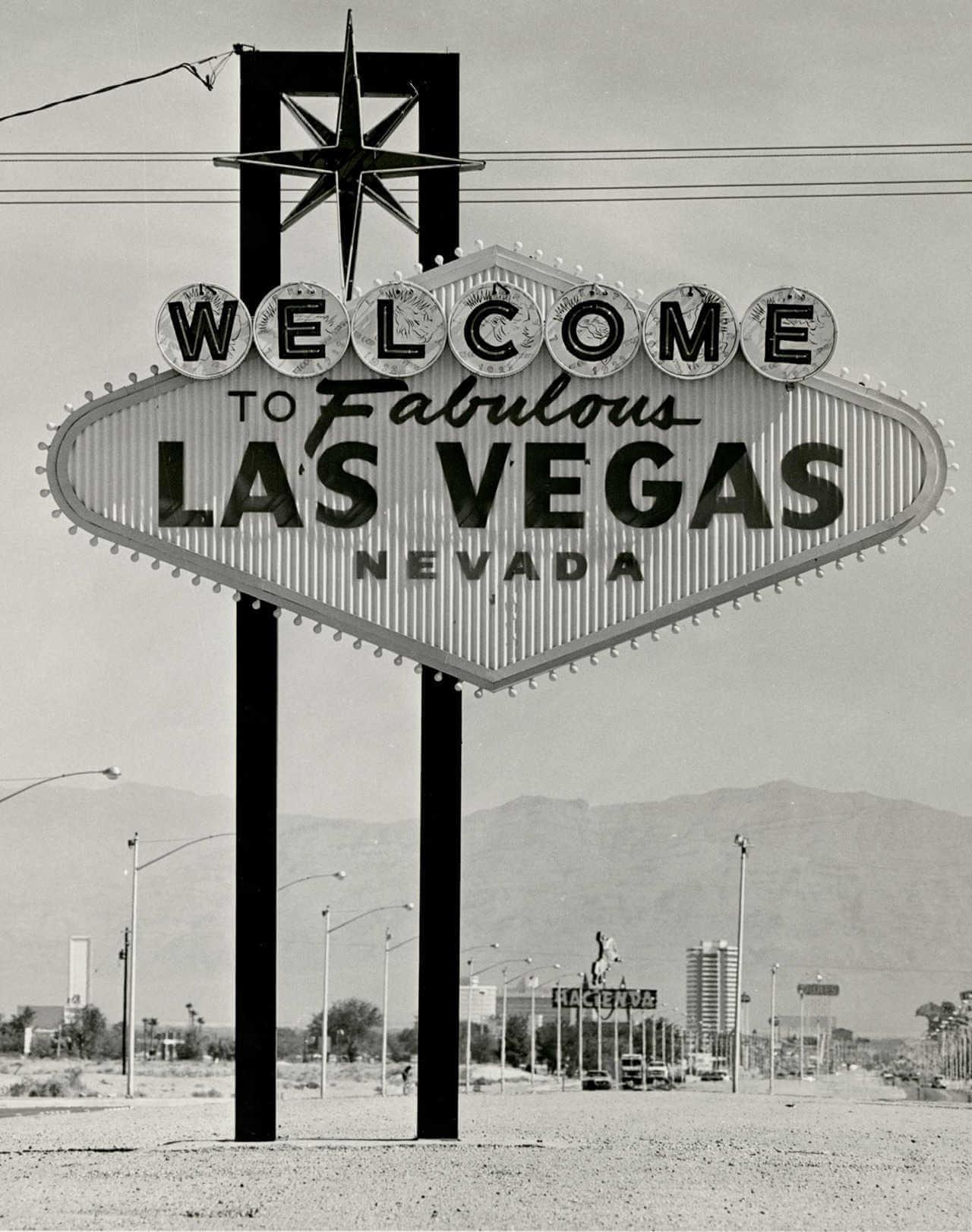 cartel de bienvenido a las vegas en los años 60