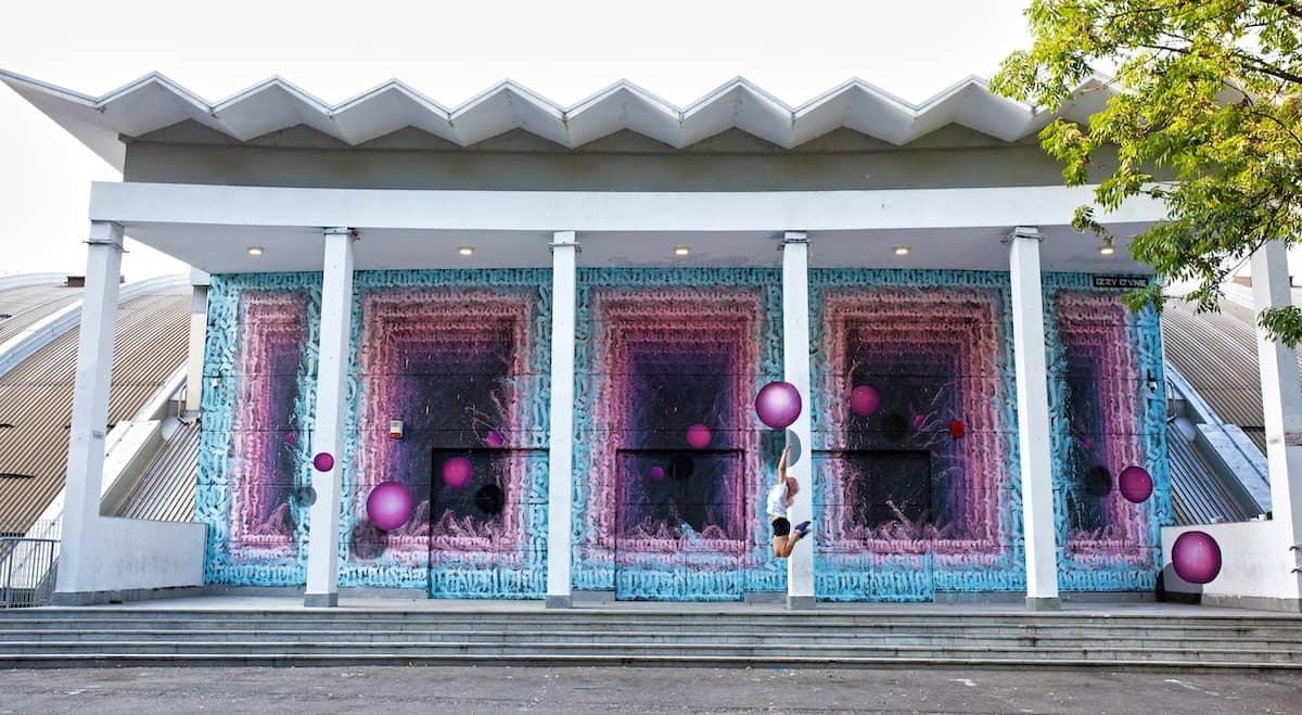 impresionante fachada pintada de arte urbano Izzi-Izvne