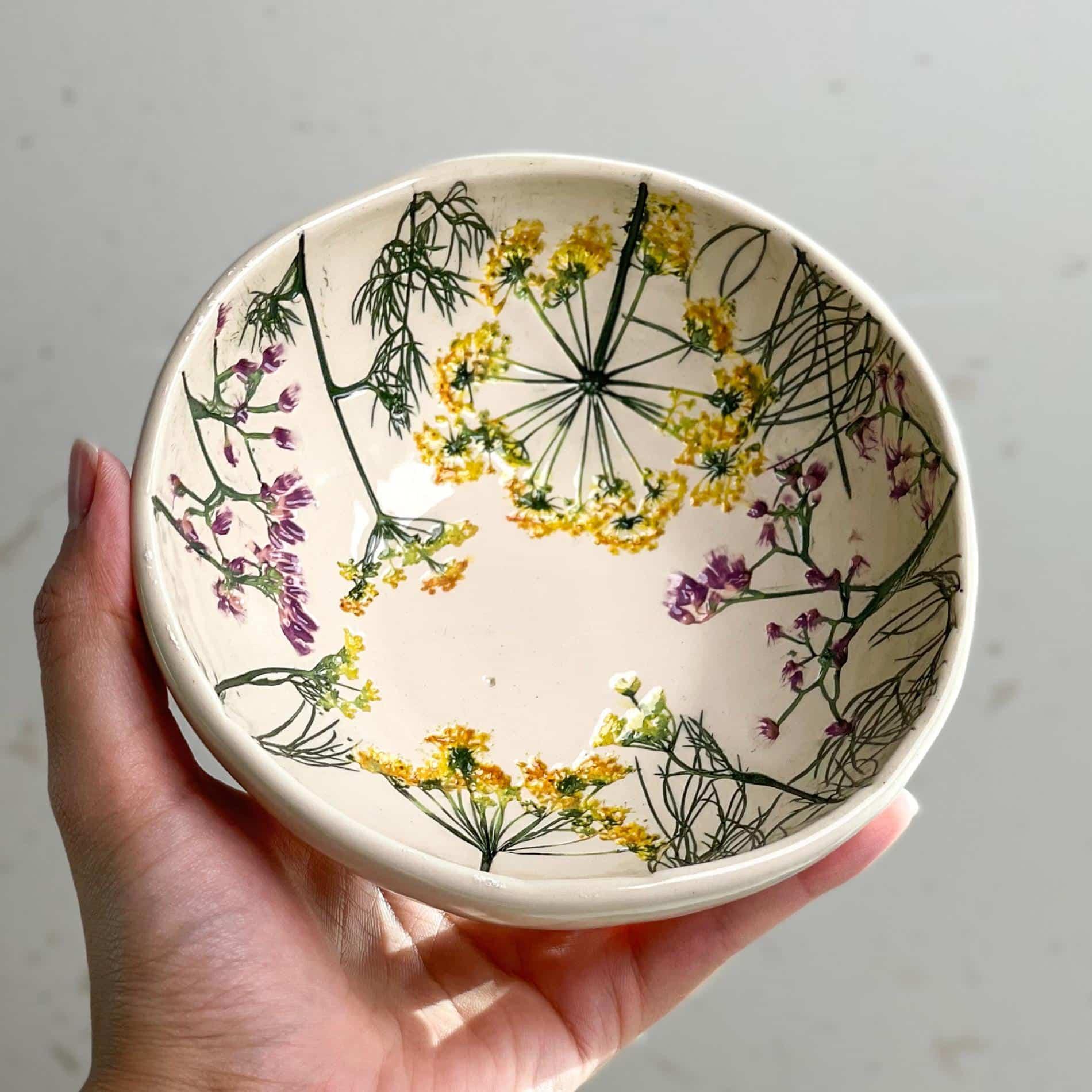 Hessa Al Ajmani bowl ceram,ica flores